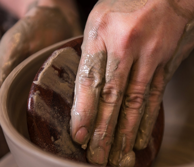 Picture of someone doing pottery